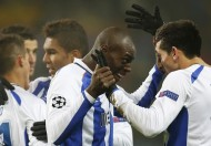 Porto's Herrera and Porto's Martins Indi celebrate after winning against BATE Borisov during their Champions League Group H soccer match at the Borisov Arena stadium outside Minsk