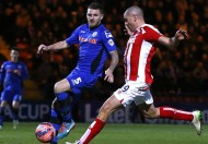 Stoke City's Walters scores a goal against Rochdale during their FA Cup fourth round soccer match at the Spotland stadium in Rochdale