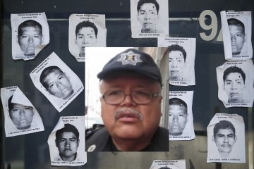 Printouts of missing Ayotzinapa Teacher Training College students are plastered on a Palo Blanco tollbooth along a road leading to Acapulco, during a blockage by FUNPEG trainee teachers